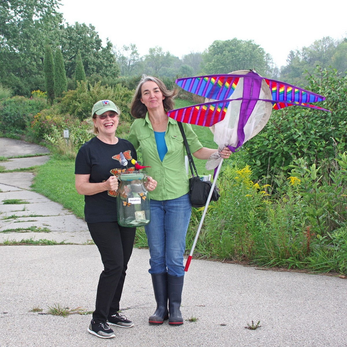 Two women outdoors with one holding a kite.